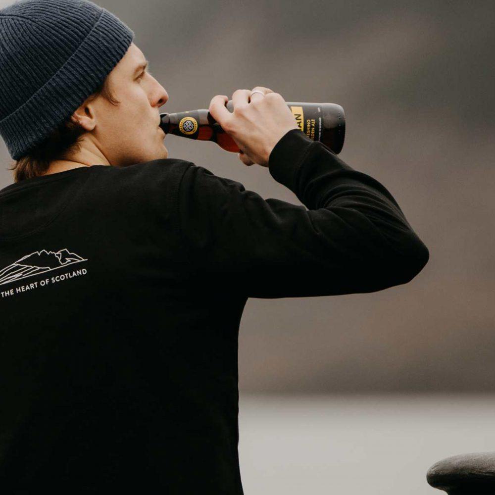 Inveralmond Ossain man drinking on beach