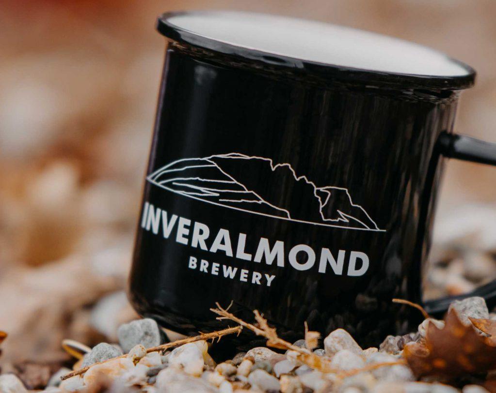 Inveralmond mug on beach